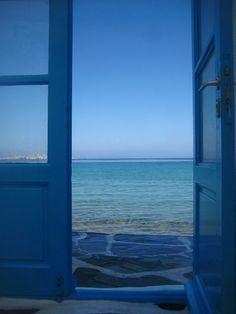 Mykonos, Greece Photo by George Stasinos Santorini, Mykonos Greece, Window View, Open Window, Life Is Beautiful, Beautiful Places, Greek Blue, Island Villa, Greek Culture