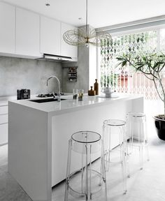 bar / kitchen island. soothing white + potted tree. #kitchen