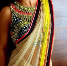 Blouse: heavy blouse with simple Saree look.