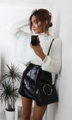 #winter #outfits black leather mini skirt and white knitted sweater