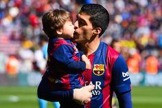Luis Suarez of FC Barcelona kisses his son Benjamin Suarez prior to the La Liga match between FC Barcelona and Rayo Vallecano de Madrid at Camp Nou on March 8, 2015 in Barcelona, Catalonia.