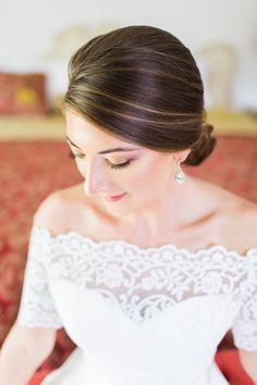 Love the clean and refined bun! View the full wedding here: http://thedailywedding.com/2015/12/24/southern-plantation-style-wedding-jessica-robert/
