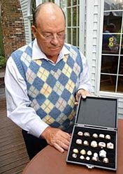 Scotty Bowman showing off his Championship rings.  (Howie Borrow/Hockey Hall of Fame)