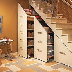 Inspiring Under Stair Storage with Smart Ideas for Designing : Under Stairs Storage Cabinets For Small Spaces On Modern Home Designed With Minimalist Cream Fronted Doors And Simple Metal Horizontal U Pull Out Handles Stair Storage, Staircase Storage, Hidden Storage, Basement Storage, Extra Storage, Stair Drawers, Secret Storage, Rolling Storage, Stair Shelves