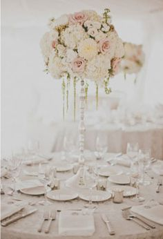 raised centerpieces on thin-stemmed rented stands