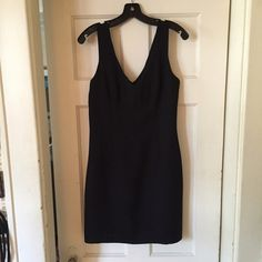 BCBG black dress Great BCBG black dress.  Perfect for going out or wearing to work.  There isn't a size tag but it's a small. Dry clean only BCBG Dresses