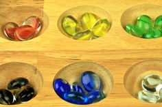 Standard Mancala game board and colorful marble tokens