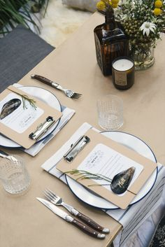 Place setting with enamel plates and mussel shell name cards.