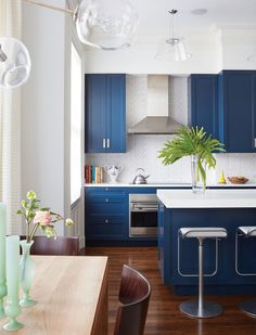 Modern kitchen with blue cabinets.
