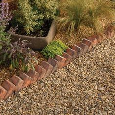 A traditional style edging which replicates the feel of bricks laid on angles to create a simple but effective classic edging detail.