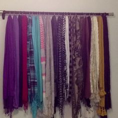 Curtain rod & shower curtain hooks. Stylish way to hang the scarves.