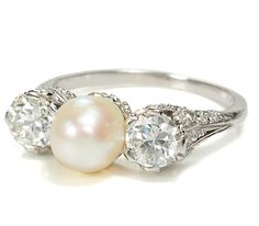 vintage pearl & diamond engagement ring circa 1920. Pearls are a symbol of love & purity. Real saltwater pearls are more rare than diamonds and were used for engagement rings until an abundance of diamonds were found in Africa at the turn of the century. Pearls and diamonds for a classic, timeless, look.