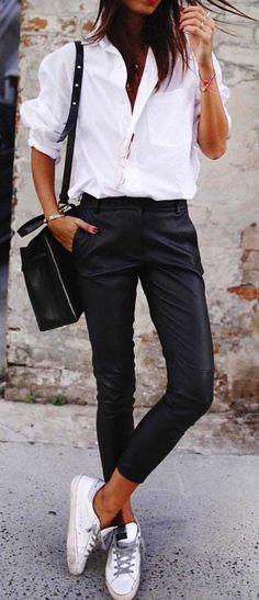 White shirt with black pants and pair of white low-top sneakers outfit. #Summer #Outfits