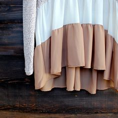 Gorgeous sheer and lightweight cut and sew sweater ruffle tunic top. Features a color block with tones of taupe, cream, and brown. Polyester/rayon blend. m