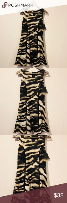 NWT Animal Print Mini Fashion Dress-Size Small NWT Animal Print Mini Fashion Dress-Size Small// Color: Dark green, Black, beige/ Materials: Polyester/Spandex/ Length is: 35 in./ If you have a questions please let me know via message!!! See my other items!! Happy shopping!!! Dresses Mini