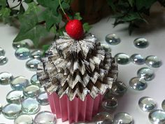 **This tutorial is intended for personal use only.**  This dainty cupcake has a hidden treat cup located in it's center.  It makes a wonderf...