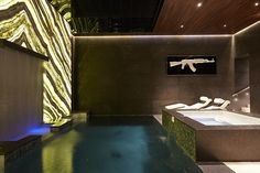 The family can relax by the indoor pool or the hot tub next to it. Backlit onyx enlivens t...
