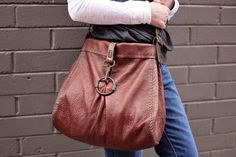 Cibado Leather Bags -  hand sewn leather bag completed with vintage or old horse tack for the handles and closure.