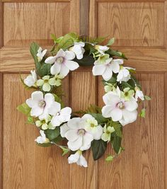 Gift the Spring Floral 22 Pink  and  Green Magnolia Dogwood Hydrangea Wreath to a dear one for a special occasion. This pretty wreath features an assortment of decorative flowers and leaves. Hang this