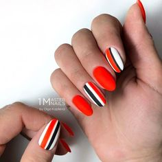 Red Nail Design With White And Black Stripes. #patternednails Whether long or short, red nails are fabulous, bright and classic at the   same time. Shiny or matte, a blood hue works great for coffin, almond   nails. #rednails #naildesigns #nailart