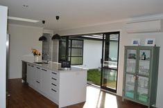 The completed kitchen with great indoor outdoor flow. Furniture, Home, Table, Kitchen, Room Divider, Indoor