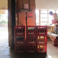 This aid kit is designed to nestle between Coca-Cola bottles to bring medicine to remote locations through the drinks company's vast distribution channels.
