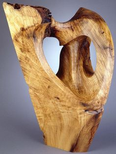 Monumental wood sculpture, a rare endeavor, an organic, sensuous encapsulation by Harry Pollitt of the chaos theory & excessive creationism - in walnut!