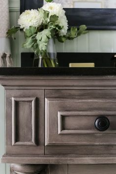 Weathered Gray Wood Look Vanity Makeover | blesserhouse.com - A vanity gets a weathered gray wood look using just chalk paint and wax. Looks so much like real weathered wood in less time with less mess!