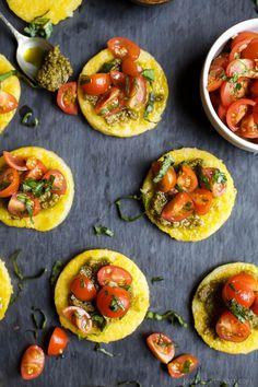 Crispy Polenta Bites with a Basil Pesto spread and topped with fresh Tomato Bruschetta.   Gluten Free Recipes   Vegetarian Recipes   joyfulhealthyeats.com