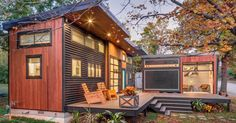 The Amplified Tiny House: a 520 sq ft home composed of a main house and a trailer, joined by a deck. Featured on the show Tiny House Nation.