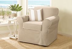 Spectator Canvas Separate Seat Slipcovers in Tan with white corded trim.