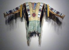 Oglala Sioux beaded and fringed hide war shirt, 51 1/2 inches long
