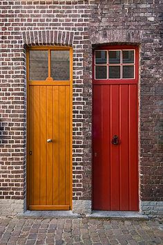 Photo ©David Sanger. Belgium, Bruges, Painted doors and brick wall.
