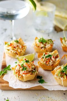 Thai Chicken Salad Wonton Cups; Wonton wrappers baked in a muffin tin to form cups, then filled with a refreshing Thai salad garnished with a little spice kick!