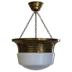 Jugendstil Light Fixture  Sweden  circa 1910  A deep, banded brass bezel, suspended from original brass chains and matching canopy, embrace the opaque white glass.