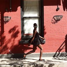 Amy Sall in a daytime LBD. {swingy dress, sunny street...I feel someone should start singing}