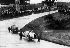Eifelrennen 1936 , Alfa Romeo 12C-36 #4 of tazio Nuvolari follows Auto Union C #18 of Bernd Rosemeyer