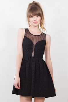 Textured skater dress with a polka dot mesh inset. Features a gold exposed zipper closure in the back #lbd