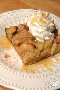 Bread Pudding with warm RumChata sauce and whipped cream. Sinfully delicious! | Country Design Style | countrydesignstyle.com