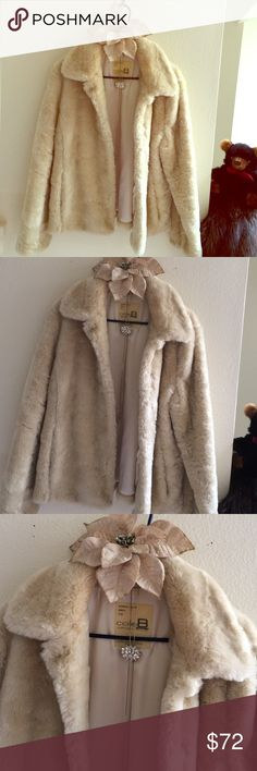 SOFT AS WHITE LUX MINK!  ITS A PLUSH FAUX FUR COAT LUXURIOUS FAUX FUR COAT!!!  FEELS AS SOFT AS IF YOU WERE WEARING A WHITE MINK OR, A CHINCHILLA FUR!!!  THE COAT IS IMPECCABLE & PERFECTLY CLEAN w/ FLAWLESS PREMIUM OFF-WHITE SATIN INTERIOR LINING OF ENTIRE COAT!  INCLUDING THE NICE SZ EXTERIOR POCKETS AS WELL!  I HAVE WORN THIS WHEN I've BEEN A SZ 6-8 & ALSO, DOWN TO A 0-2!     THIS COAT HAS AN IDEAL COLOR & LOOK TO IT & REALLY LOOKS EQUALLY FABULOUS NO MATTER DAY/NIGHT or, WHAT LOOK/ATTIRE…