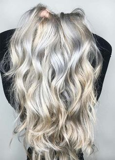 Icy Silver White Balayage Hair Icy silver white and warm light blonde ombre pair together for a silver and white gold hair experience that looks beautiful in long waves. This is another silver gray balayage treatment that shows off the skill of a great stylist.
