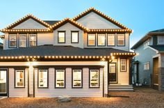 Take a photo tour of Broadview Homes. We unite a contemporary building philosophy & essential design considerations to create luxurious modern living. Contemporary Building, New Home Communities, New Home Builders, Sorrento, How To Take Photos, Calgary, Photo Galleries, New Homes, Exterior