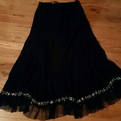 Beautiful long beaded bottom skirt. Beautiful in great condition long skirt. This long skirt has a side zipper. The bottom of this skirt is absolutely gorgeous! Skirts Circle & Skater