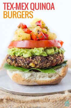GLUTEN-FREE & VEGAN Tex-Mex Quinoa Burgers packed with char-grilled veggies and topped with all the classics (including PINEAPPLE SALSA)