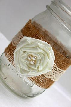embellished mason jars - burlap/rosettes/lace....could also make the sewing pattern or paper flowers during the class