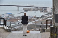William offers a silent prayer for the victims of the 11 March 2011 earthquake and Tsunami disaster as he visits a hilltop in Ishinomaki that overlooks the 'Bay of Disaster'