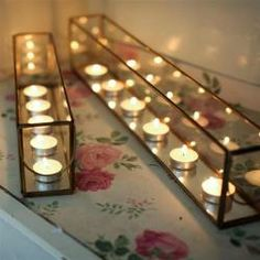 These elegant candle holders look beautiful as a center piece on a dining table, coffee table or on a mantle with t lights flickering inside. They have an antique brass finish, they could also be used for flower arrangements on the table too.L56cm x H10.5cm x W7cm