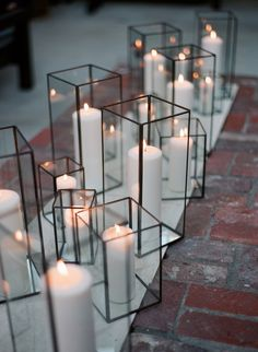 white pillar candles in glass hurricanes, ceremony idea, wedding aisle inspiration