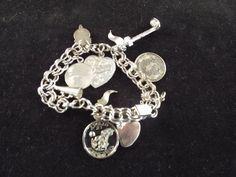Vintage Sterling Silver Charm link bracelet by Burnedbunnybling