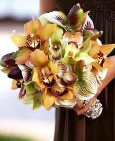 Stunning Bridal Bouquet: White Gardenias + Orange Cymbidium Orchids   Bridesmaid's Bouquet: Cream Roses, Orange Cymbidium Orchids, Lime Cymbidium Orchids, Purple/Green Lady's Slipper Orchids